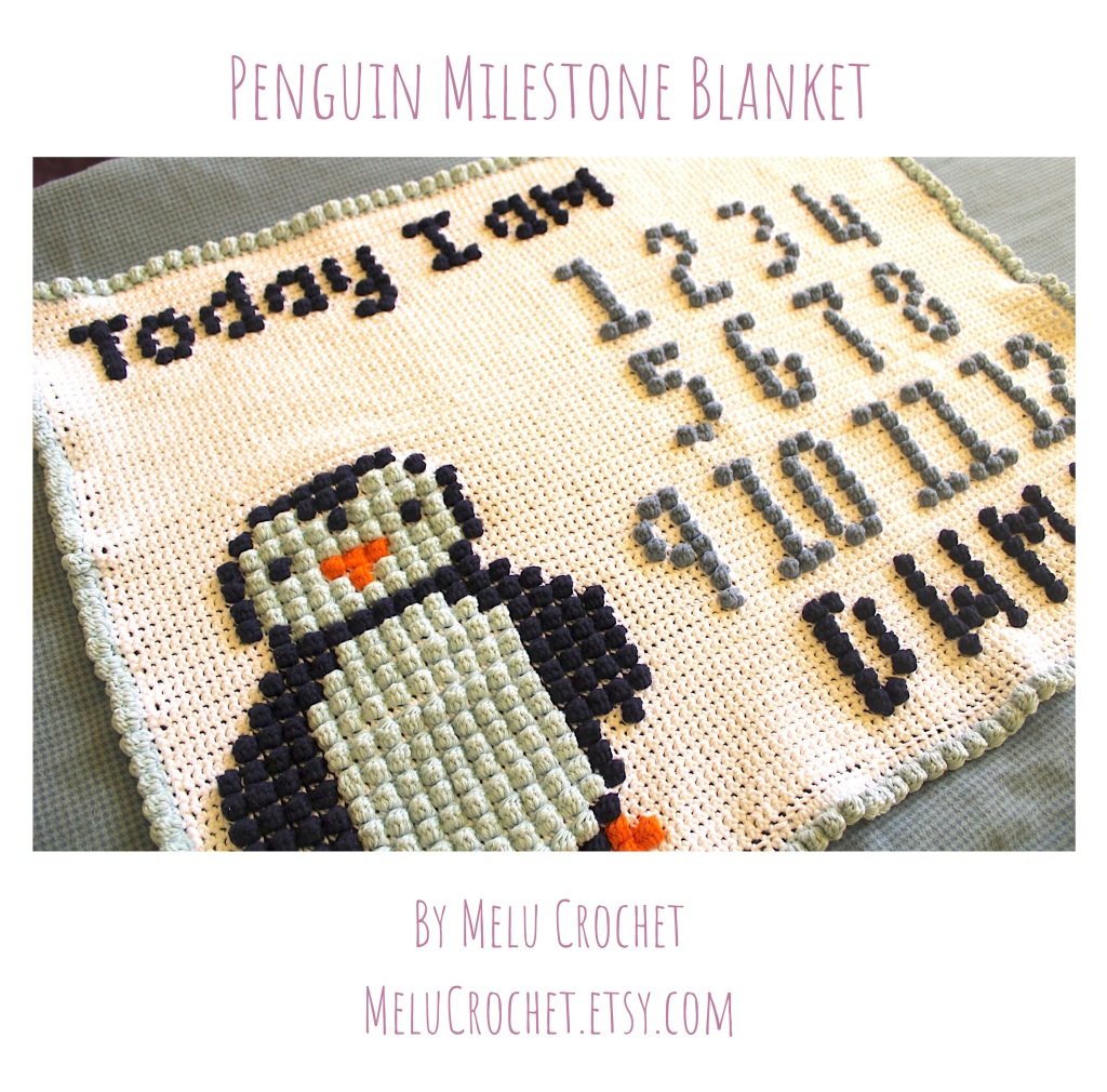Crocheted blanket with a penguin and  'today I am' and numbers and letters for day week month year to mark to mark on baby's milestones